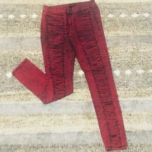 Red and black skinny leg jeans
